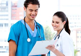 nurse showing some medical records to a fellow nurse